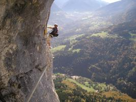 Man climbing a steep cliff